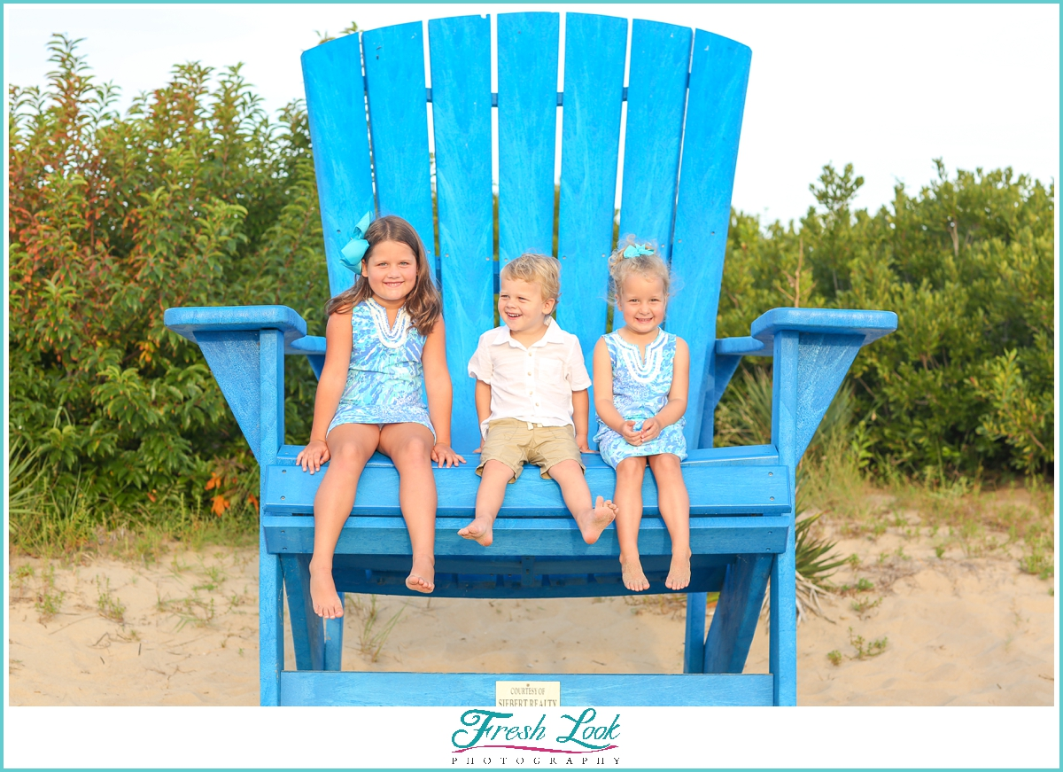 kids sitting in oversized chair in VIrginia Beach