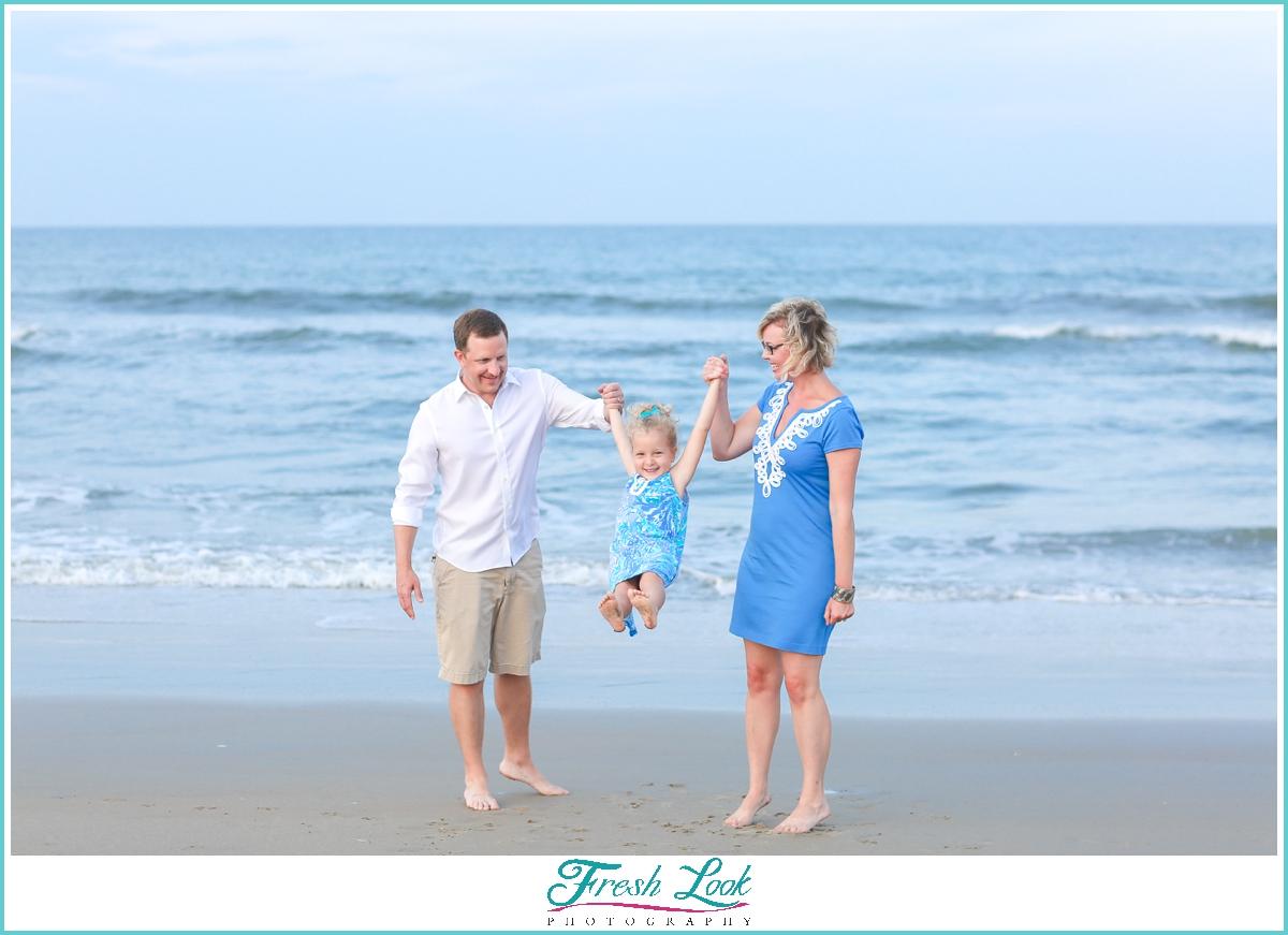 fun beach family photos in Sandbridge