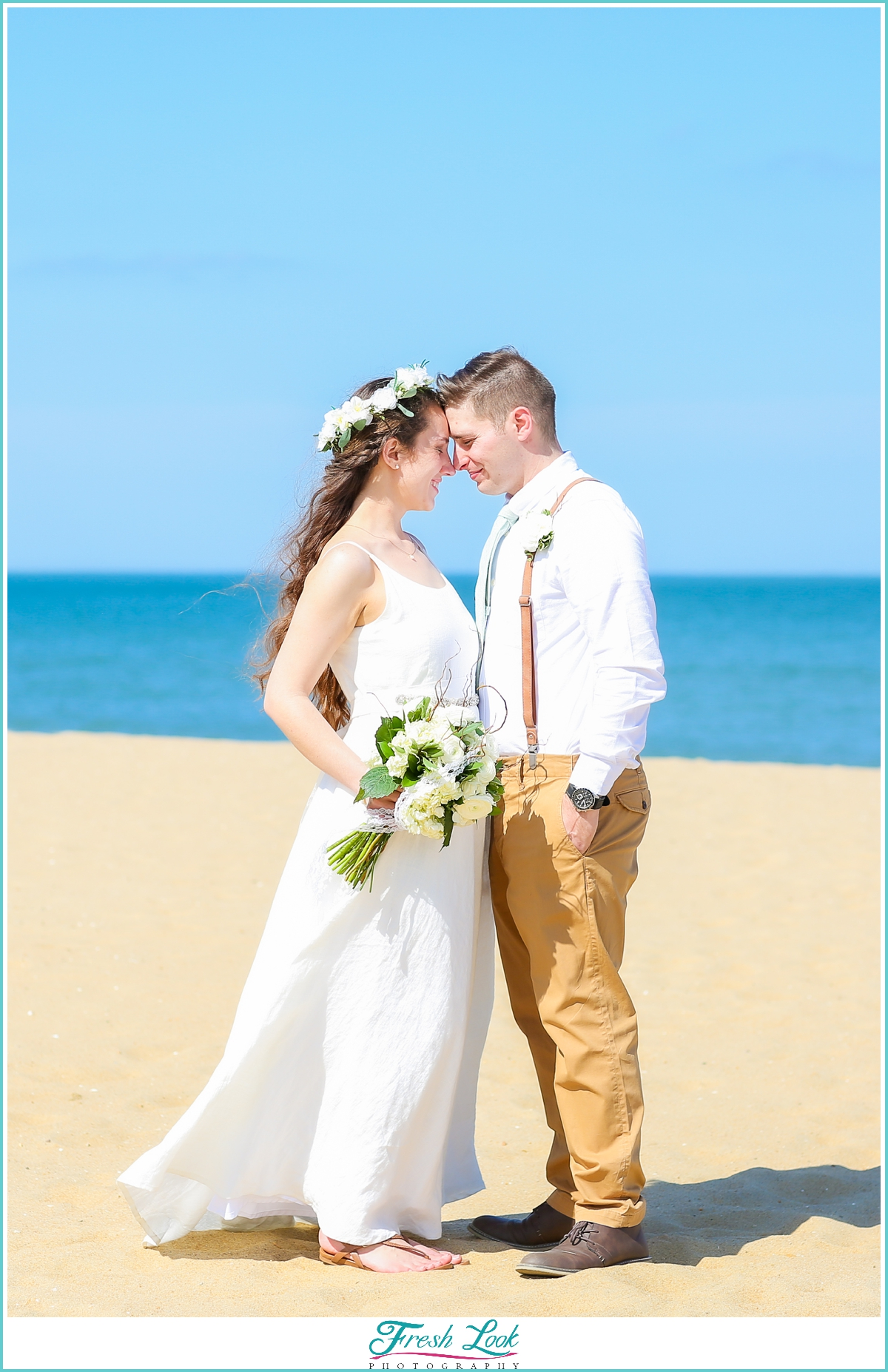 bride and groom on beach photoshoot