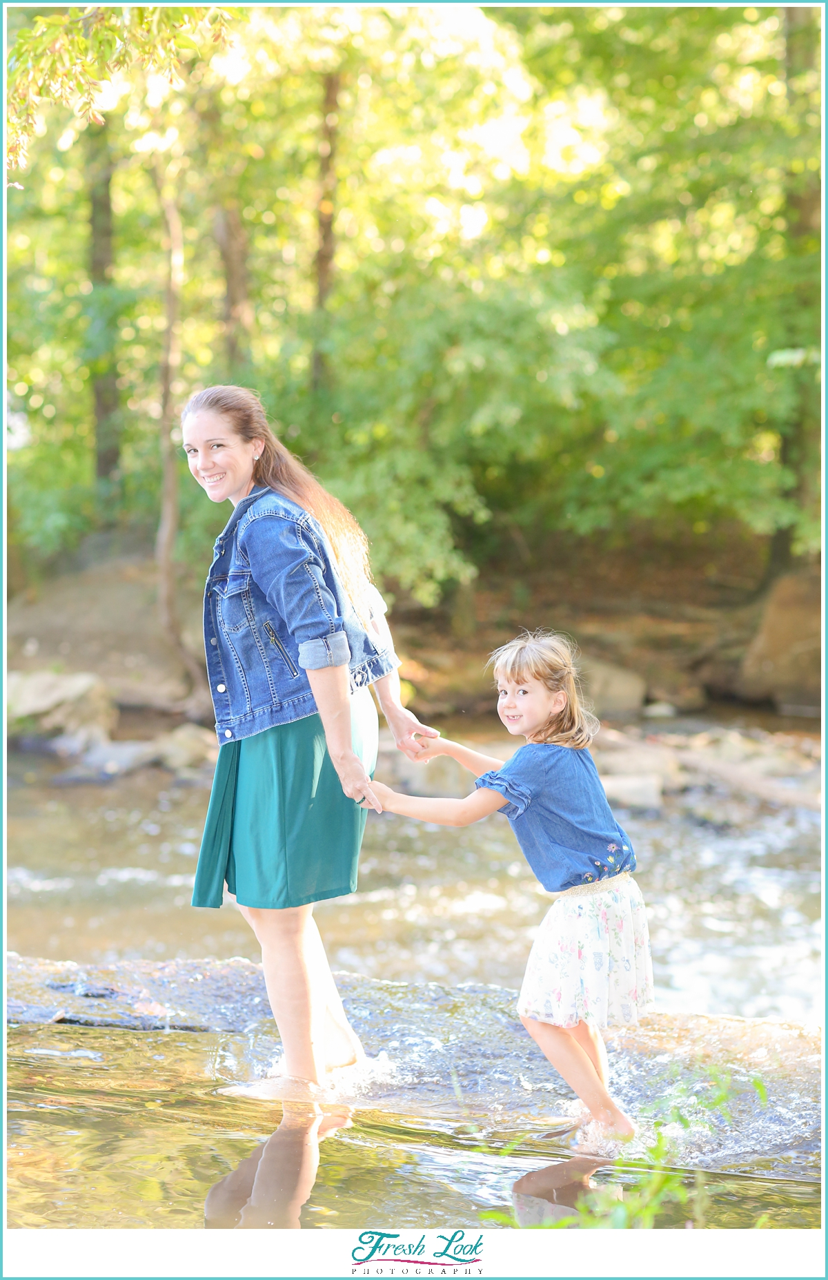 mother and daughter walking in the water
