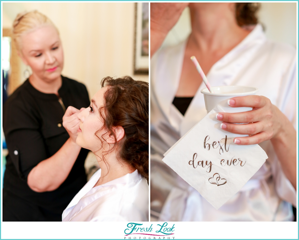 bride getting makeup done before the wedding