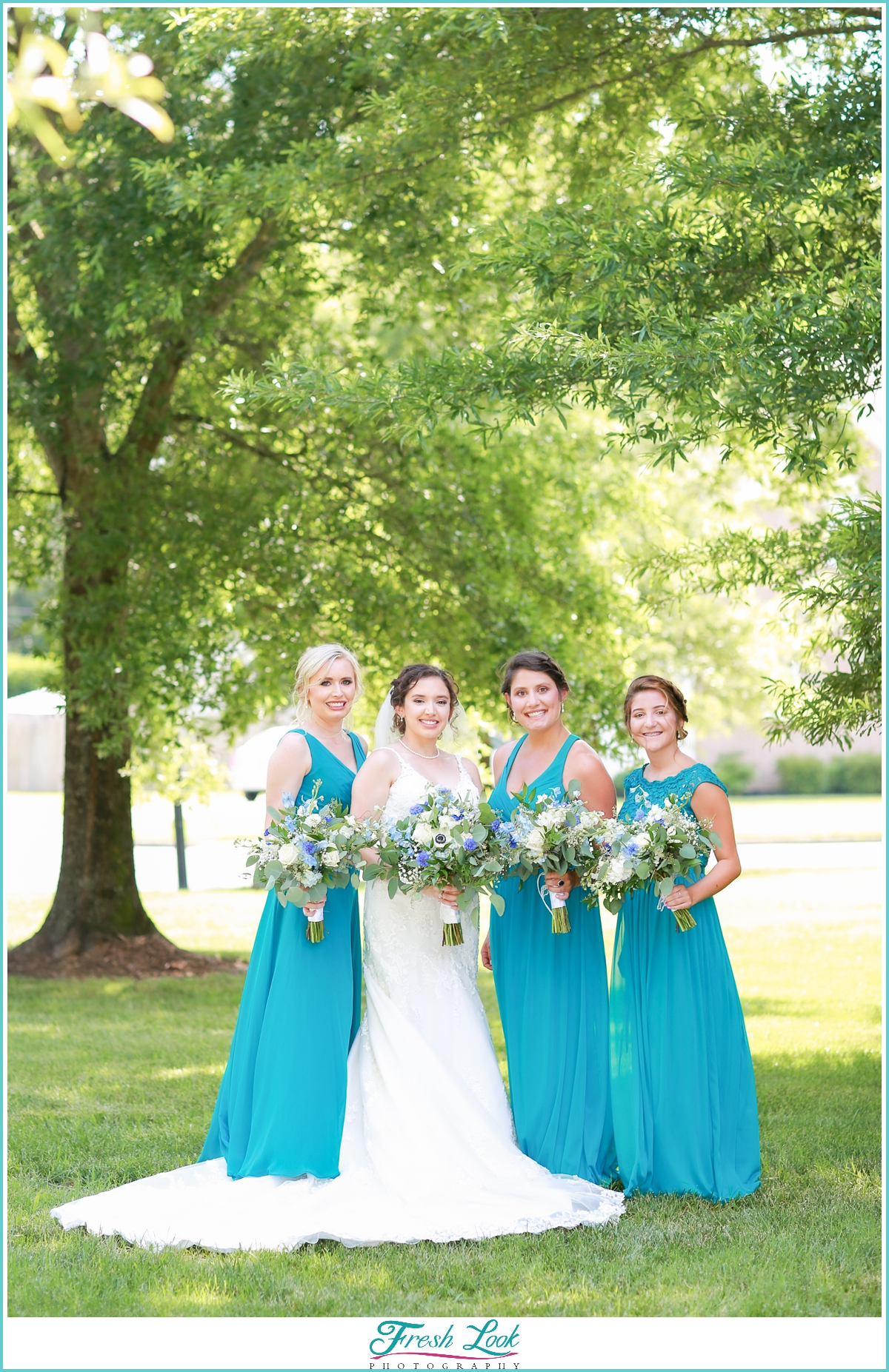 bride and bridesmaids wearing teal