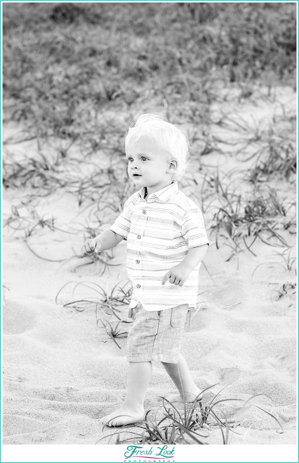 handsome little man on the beach