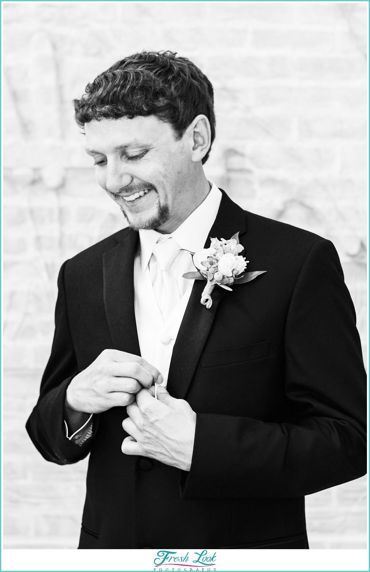 black and white groom portrait