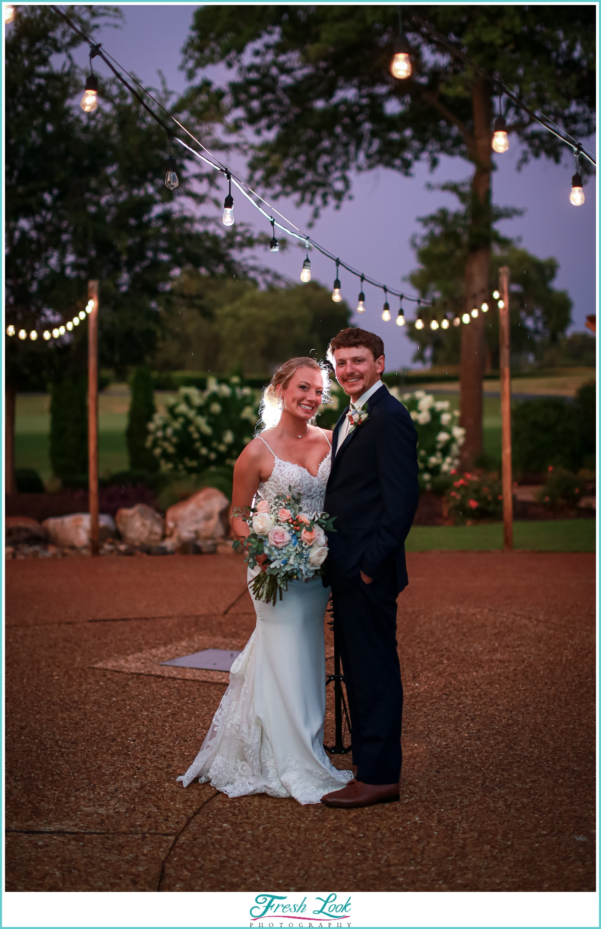 Bride and groom portraits with string lights