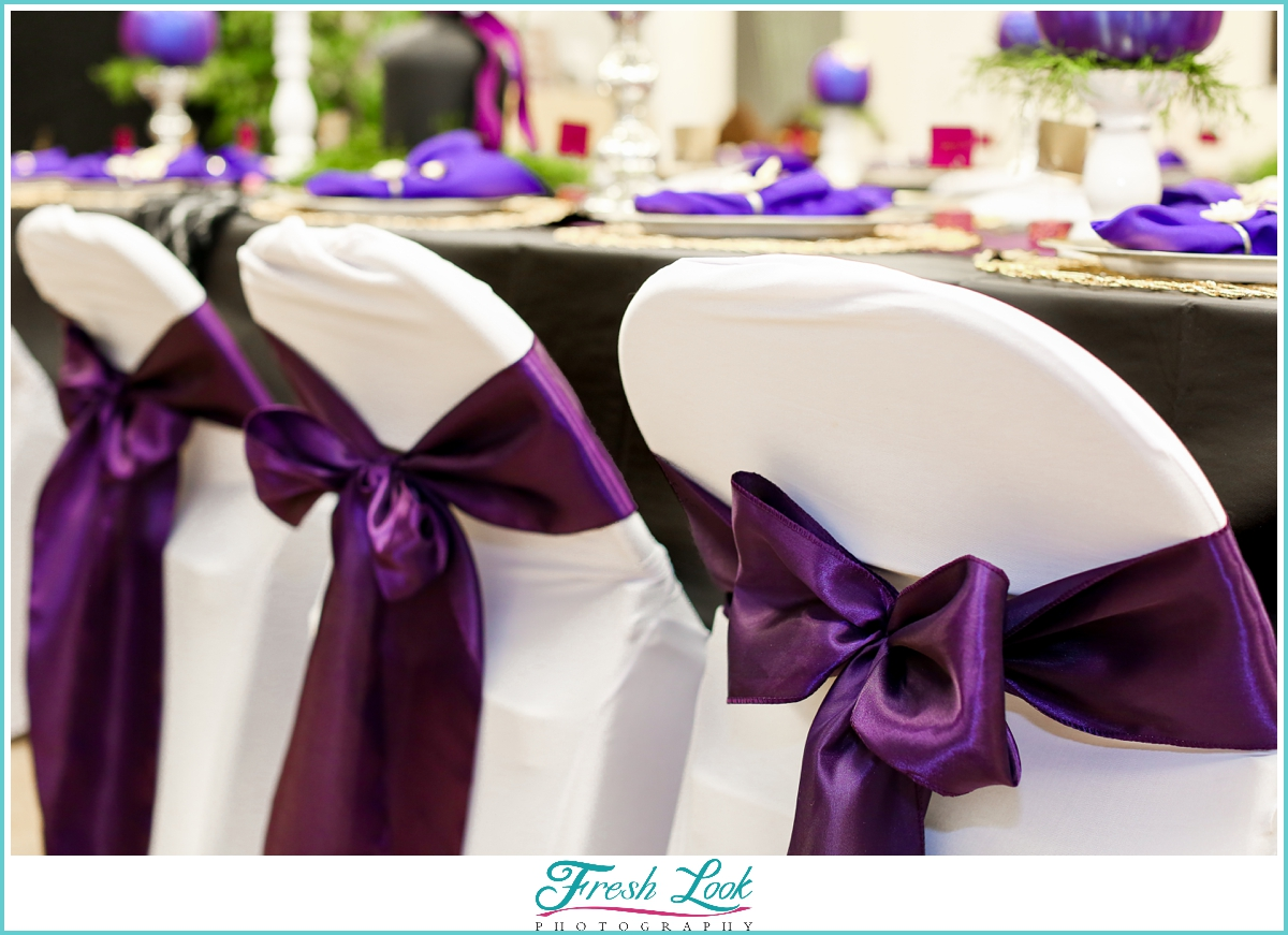 purple chair bows at reception