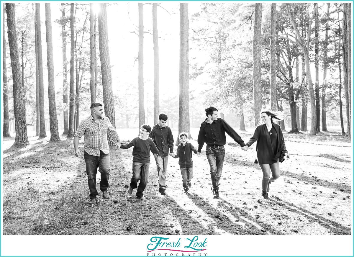 family running through the woods together