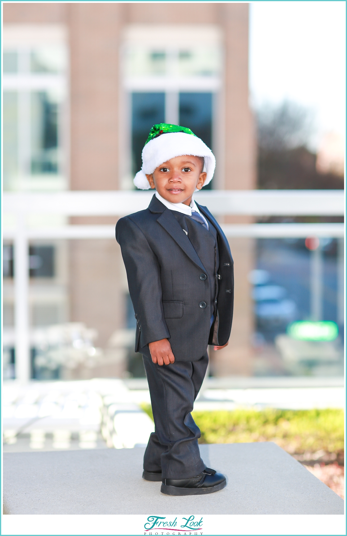 handsome little guy wearing Christmas hat
