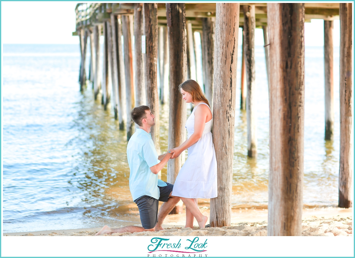 beach proposal on the sand