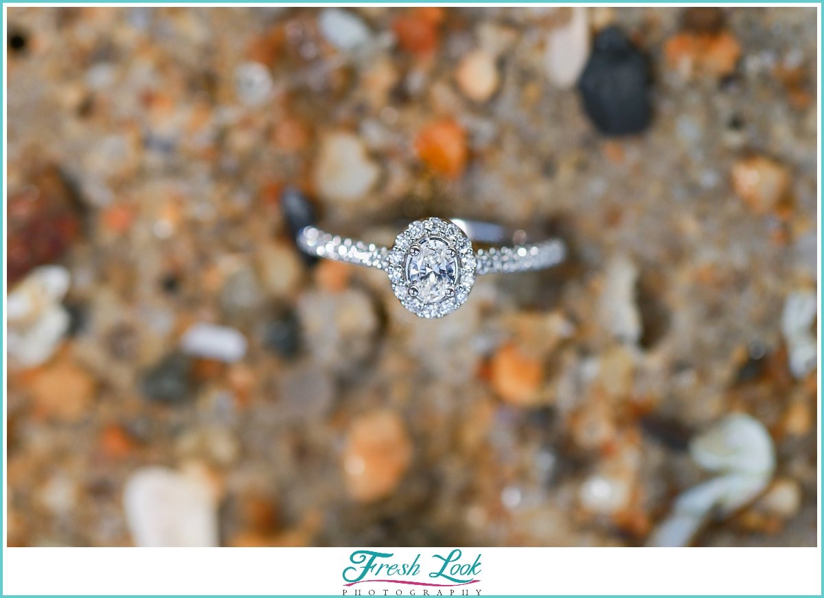 diamond engagement ring in the sand