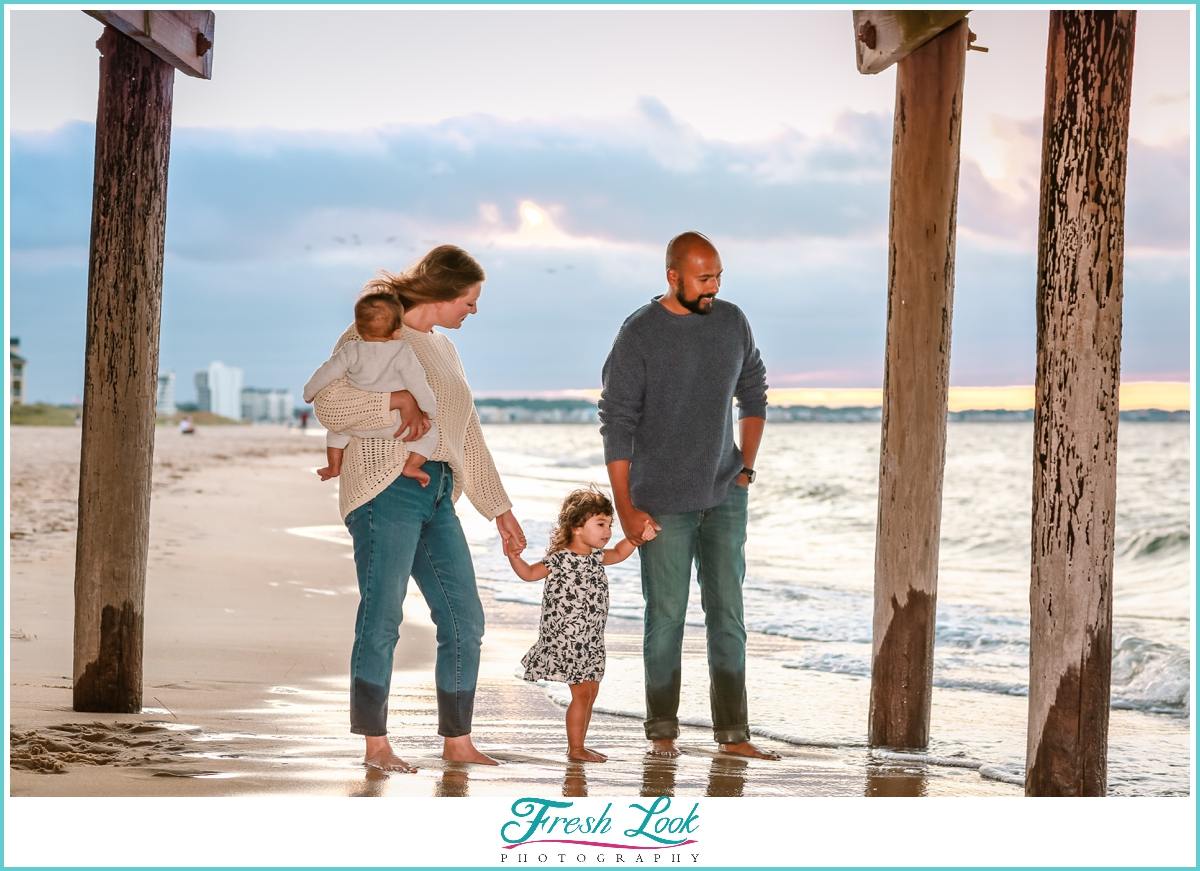 family photoshoot under the pier