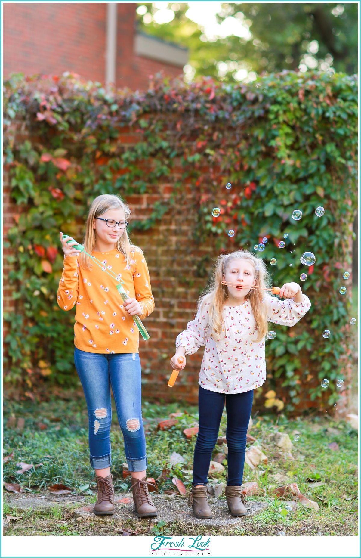 girls blowing bubbles at photoshoot