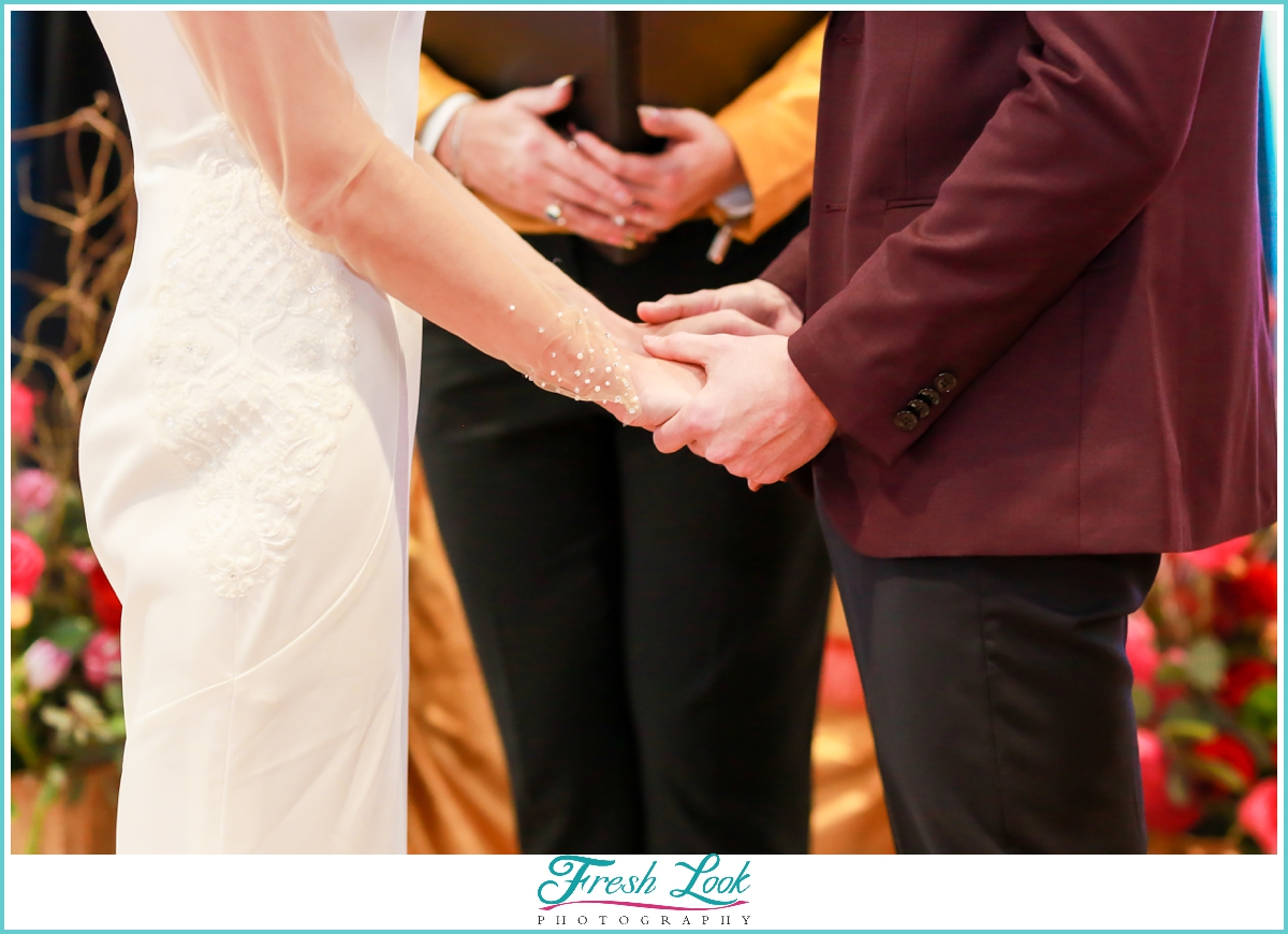 bride and groom exchanging vows at wedding ceremony