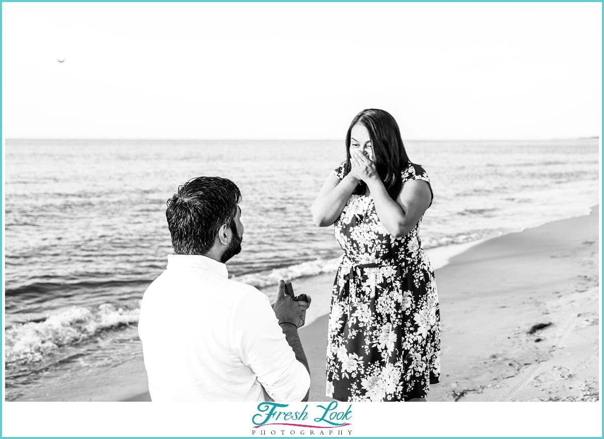 surprise proposal on the beach