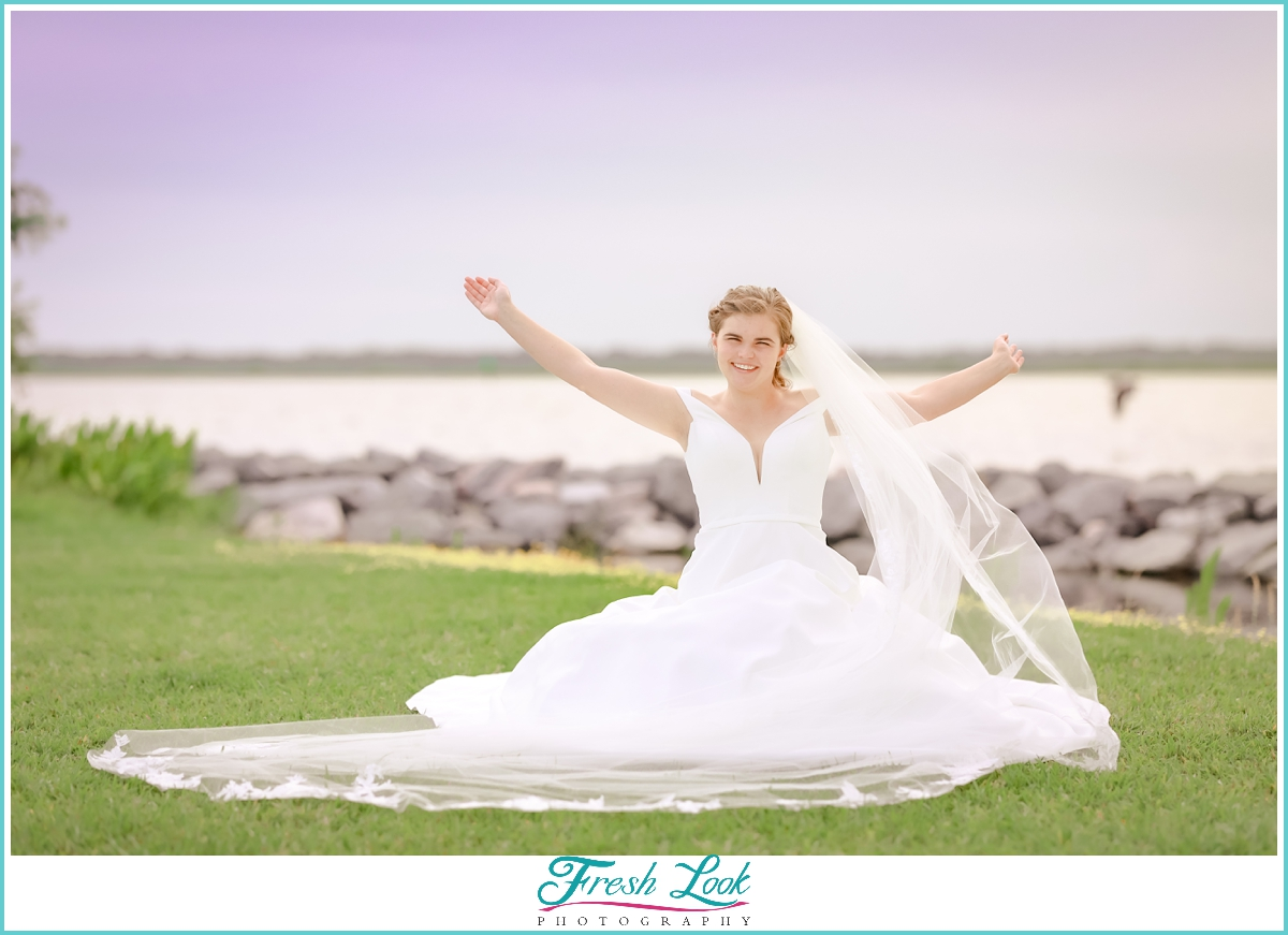 excited bride by the water