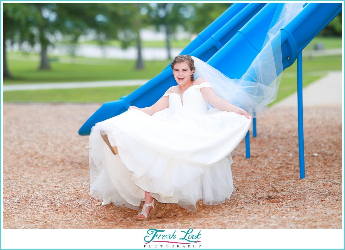 Bride sitting on the slide