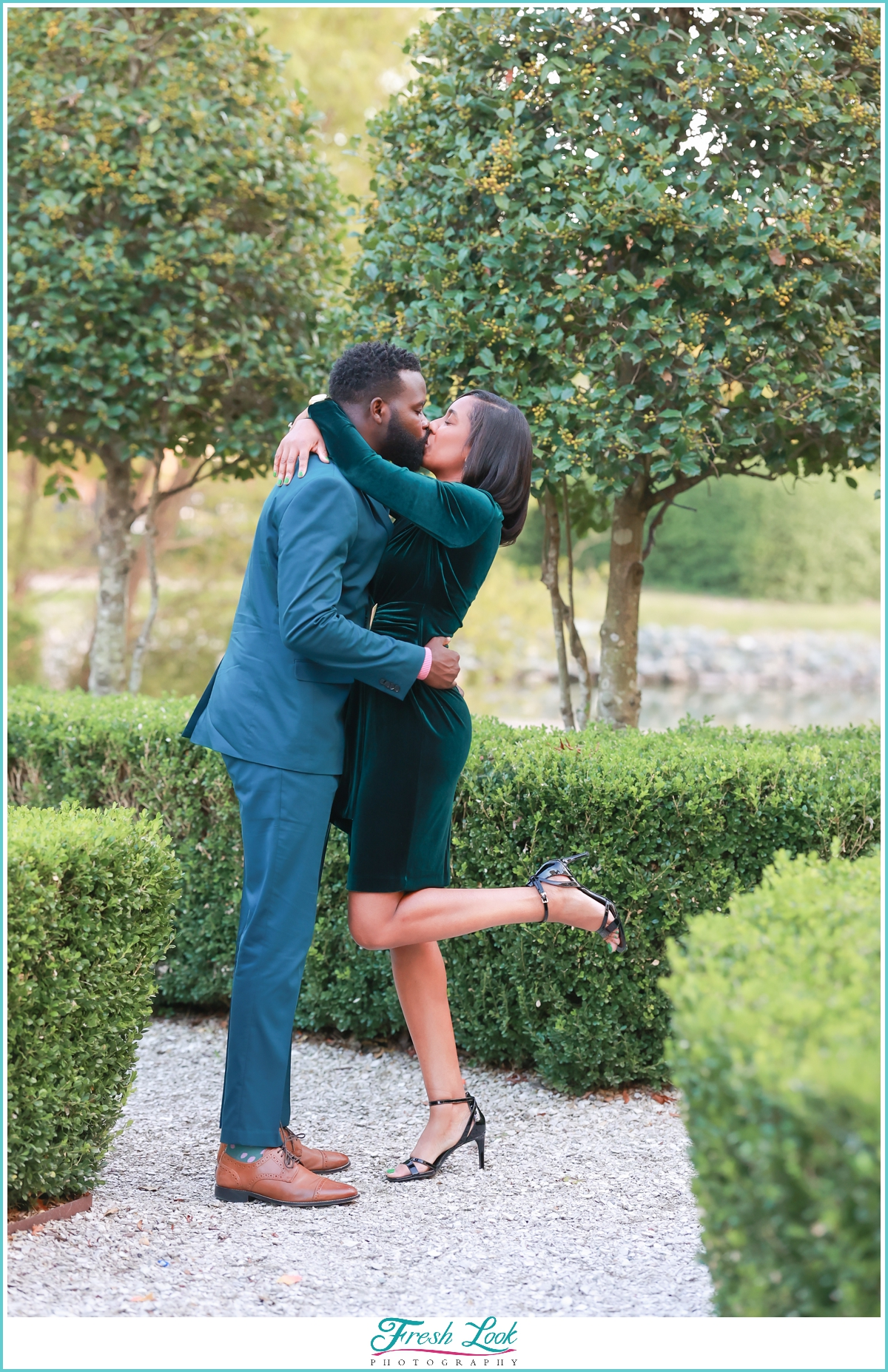romantic kiss at engagement session