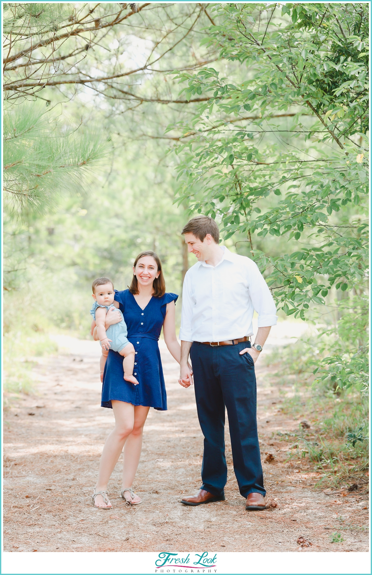 family of three photoshoot in the woods